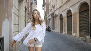 Swiss/French pop star Ginta demonstrates Mictic's wearable musical instrument on the streets of Rome.