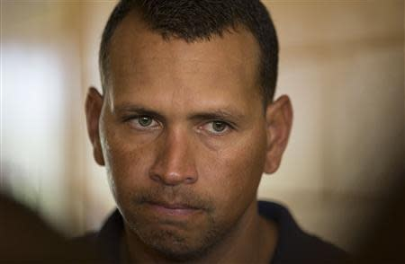 New York Yankees' Alex Rodriguez talks with reporters outside the Lakeland Flying Tigers visitor's clubhouse in Lakeland, Florida