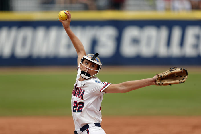 Arizona's Alyssa Denham (22) delivers a pitch against Florida State in the second inning of an NCAA Women's College World Series softball game on Saturday, June 5, 2021, in Oklahoma City. (AP Photo/Alonzo Adams)