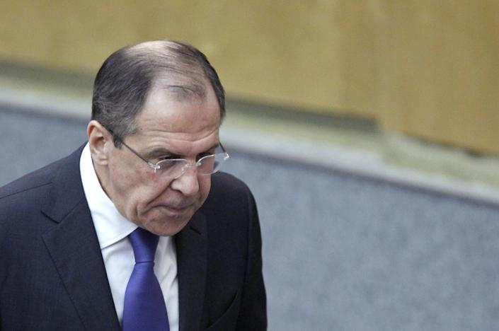 Russian Foreign Minister Sergey Lavrov walks at the State Duma, the lower parliament chamber, Moscow, Russia, Wednesday, March 14, 2012. Lavrov says Moscow is providing Syria with weapons to fend off external threats but has no intention to use military force to protect Syrian President Bashar Assad. (AP Photo/Misha Japaridze)