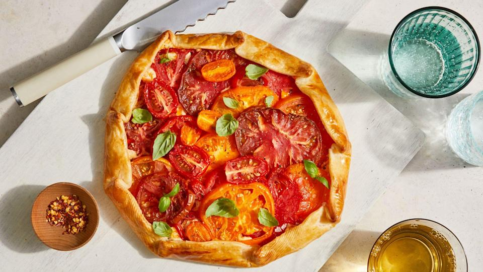 """<p><strong>Recipe: </strong><a href=""""https://www.southernliving.com/recipes/tomato-galette"""" rel=""""nofollow noopener"""" target=""""_blank"""" data-ylk=""""slk:Tomato Galette"""" class=""""link rapid-noclick-resp""""><strong>Tomato Galette</strong></a></p> <p>Don't fuss with homemade pie crust and make this stunning and easy tomato galette instead.</p>"""
