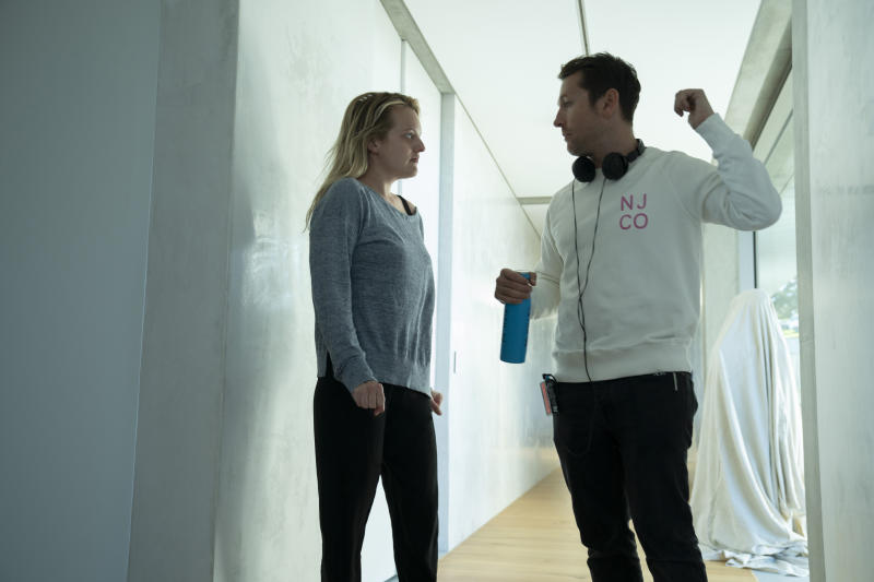 (from left) Elisabeth Moss and writer/director Leigh Whannell on the set of <i>The Invisible Man</i>. (Mark Rogers/Universal Pictures)