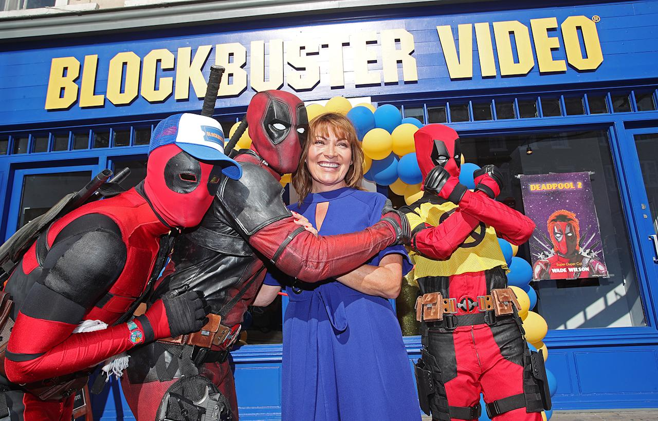 <p>ITV's Lorraine poses with Deadpool cosplayers outside the new Blockbuster on Bethnal Green Road. (20th Century Fox) </p>
