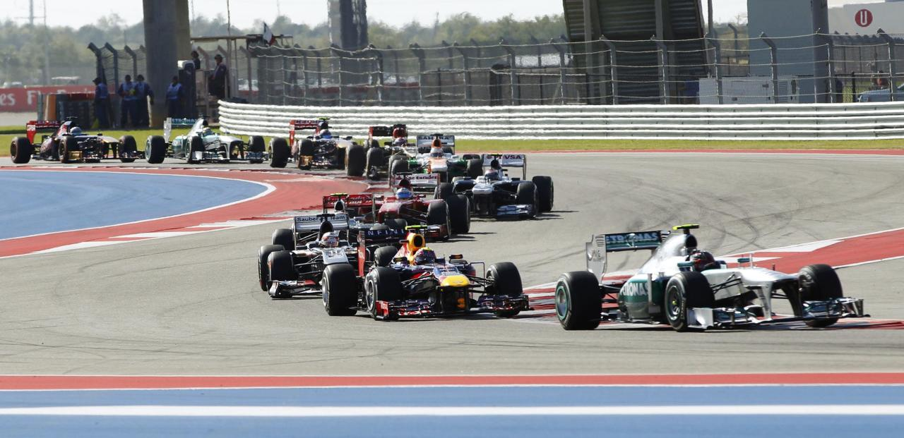 Mercedes Formula One driver Lewis Hamilton (R) of Britain makes a turn during the Austin F1 Grand Prix at the Circuit of the Americas in Austin November 17, 2013. REUTERS/Mike Stone (UNITED STATES - Tags: SPORT MOTORSPORT F1)