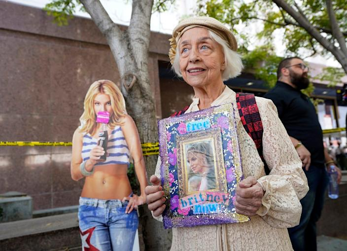 Britney Spears supporter Mona Montgomery of Glendale, Calif., demonstrates outside the Stanley Mosk Courthouse, Wednesday, Sept. 29, 2021, in Los Angeles. A Los Angeles judge will hear arguments at a hearing Wednesday over removing Spears' father from the conservatorship that controls her life and money and whether the legal arrangement should be ended altogether.