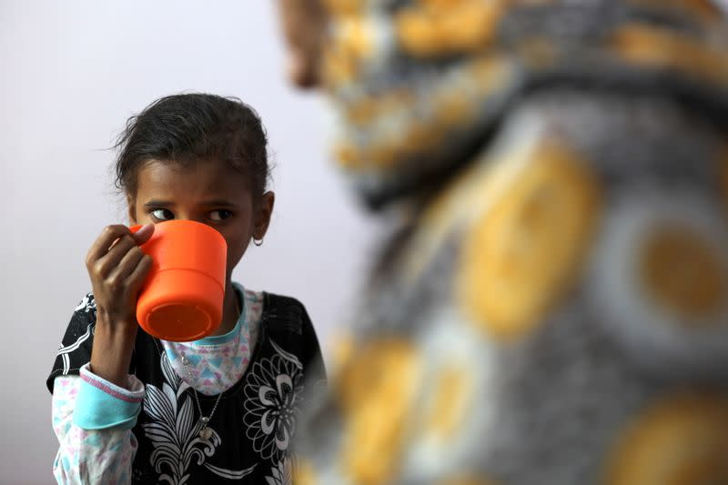 Ahmadiya Juaidi, 13, drinks a supplemental nutrition shake at malnutrition treatment ward of al-Sabeen hospital in Sanaa
