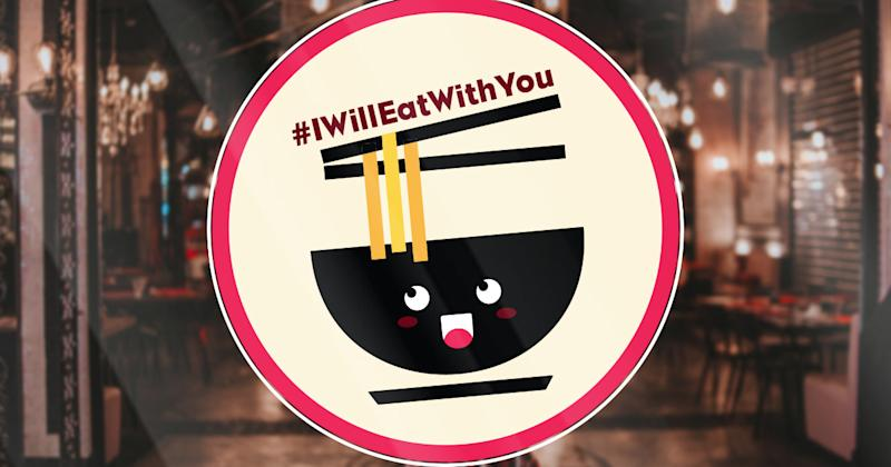 This is the #IWillEatWithYou campaign logo. It is a bowl of noodles with chopsticks. The campaign logo is on top of the chopsticks.