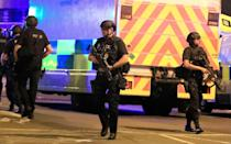 <p>Armed police respond after reports of an explosion at Manchester Arena during an Ariana Grande concert in Manchester, England, Monday, May 22, 2017. Several people have died following reports of an explosion Monday night at the concert in northern England, police said. A representative said the singer was not injured. (Peter Byrne/PA via AP) </p>