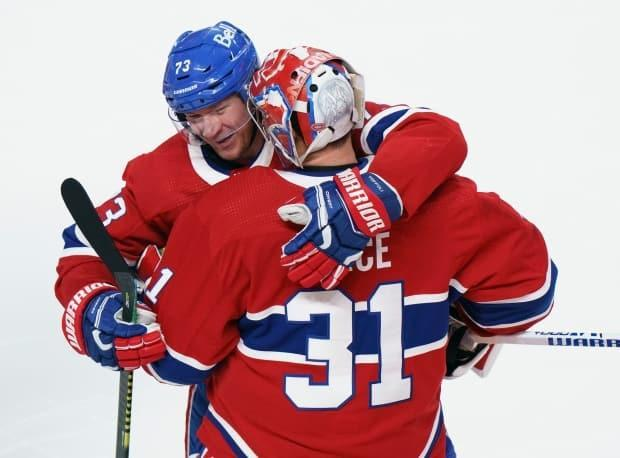 Canadiens forward Tyler Toffoli, front, pictured celebrating his game-winning goal with teammate Carey Price on Monday, propelled the team to the Stanley Cup semifinals. (Paul Chiasson/Canadian Press - image credit)