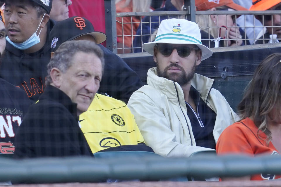 San Francisco Giants CEO Larry Baer, left, and Golden State Warriors basketball player Klay Thompson watch a baseball game between the Giants and the Los Angeles Dodgers in San Francisco, Sunday, Sept. 5, 2021. (AP Photo/Jeff Chiu)