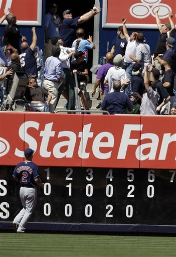Cleveland Indians left fielder Aaron Cunningham (2) chases a ball hit by New York Yankees' Robinson Cano for a two-run home run during the sixth inning of a baseball game, Wednesday, June 27, 2012, in New York. (AP Photo/Frank Franklin II)