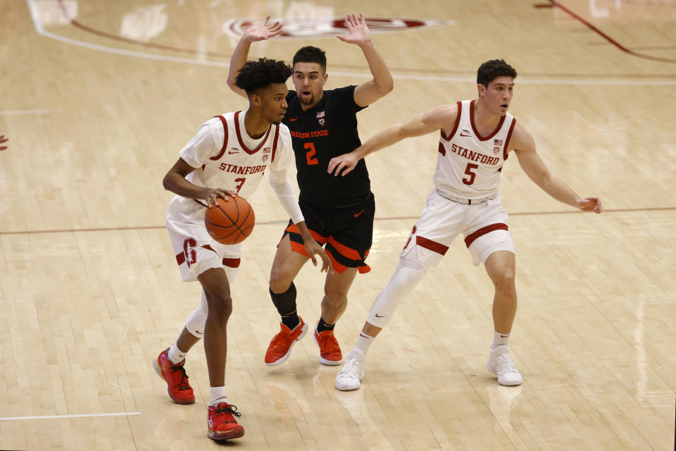 Stanford forward Ziaire Williams (3) brings the ball up against Oregon State guard Jarod Lucas (2) during the first half of an NCAA college basketball game in Stanford, Calif., Saturday, Feb. 27, 2021. (AP Photo/Josie Lepe)