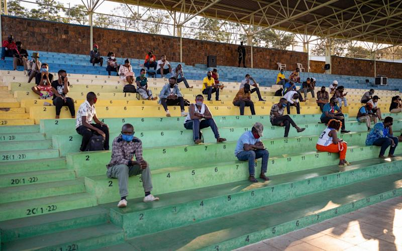 People listen the prevention speeches for a few hours in Nyamirambo stadium in Kigali, Rwanda - AFP