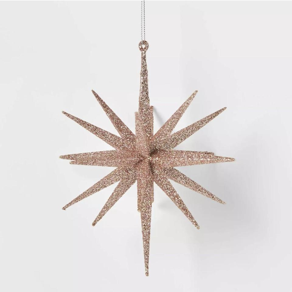 <p>A <span>5.8in Blush Plastic Spike Starburst Christmas Tree Ornament</span> ($3) is sure to turn heads. </p>
