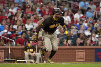 San Diego Padres' Tommy Pham runs to first on an RBI single during the fourth inning of a baseball game against the St. Louis Cardinals Saturday, Sept. 18, 2021, in St. Louis. (AP Photo/Jeff Roberson)