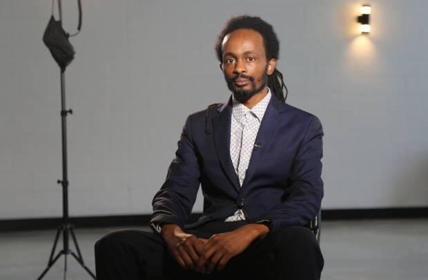 Yusuf Shire, 32, is originally from Somalia and came to New Brunsiwck in 2007. Ever since, he has been a volunteer for the New Brunswick African Association. (Maria Jose Burgos/CBC - image credit)