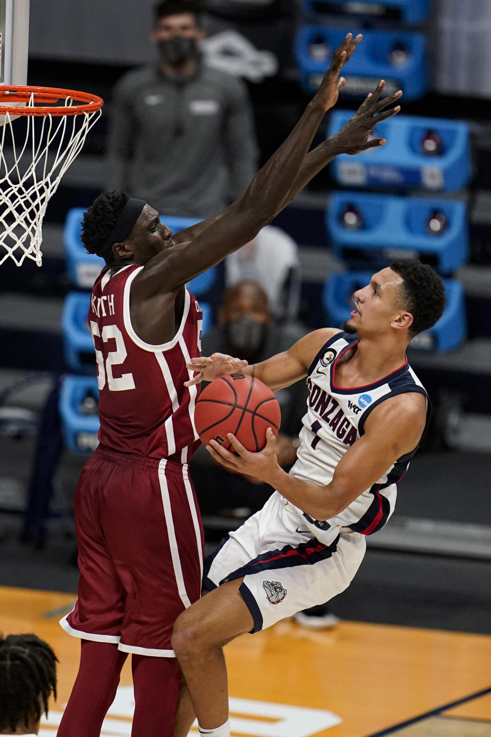 Gonzaga guard Jalen Suggs (1) shoots around Oklahoma forward Kur Kuath (52) in the second half of a second-round game in the NCAA men's college basketball tournament at Hinkle Fieldhouse in Indianapolis, Monday, March 22, 2021. (AP Photo/Michael Conroy)
