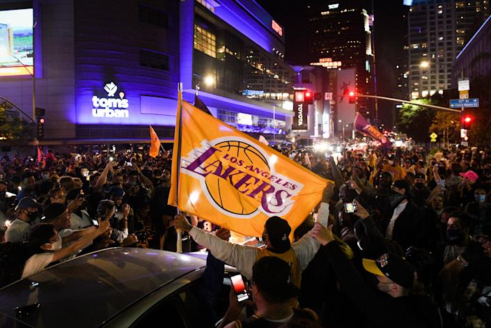 Lakers fans celebrate the franchise's NBA championship in the streets of Los Angeles on Sunday night.