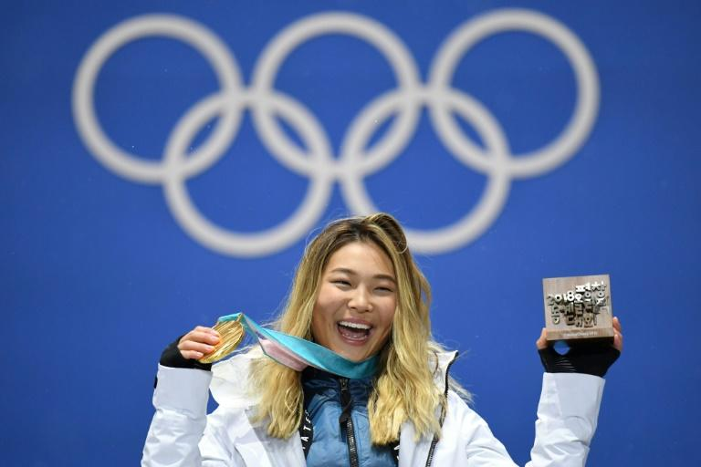 Chloe Kim poses with her gold medal on the podium during the medal ceremony for the snowboard women's Halfpipe at the Pyeongchang Medals Plaza during the Pyeongchang 2018 Winter Olympic Games in Pyeongchang on February 13, 2018