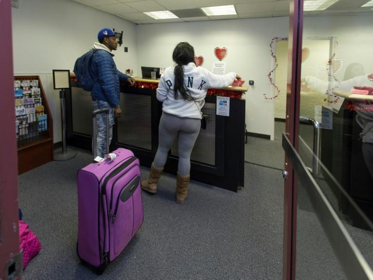 Teaira Thompson and James Anderson of Burlington, Iowa, complete their paperwork at the temporary marriage license office at McCarran International Airport in Las Vegas, which issues about 1,500 licenses on Valentine's Day