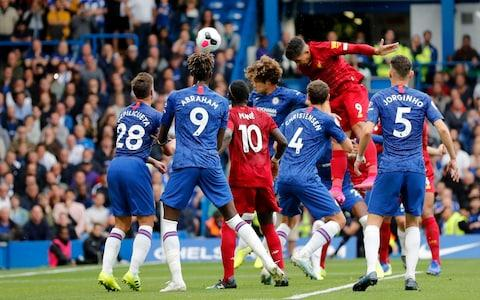 Liverpool's Roberto Firmino scores his side's second goal on a header during the British Premier League soccer match between Chelsea and Liverpool, at the Stamford Bridge Stadium, London, Sunday, Sept. 22, 2019 - Credit: AP