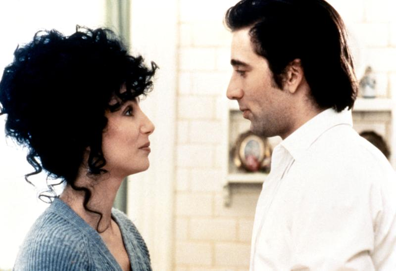 American actress and singer Cher and actor Nicolas Cage on the set of Moonstruck, directed and produced by Canadian Norman Jewison. (Photo by Sunset Boulevard/Corbis via Getty Images)
