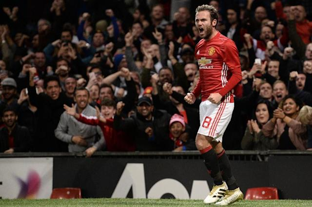 Manchester United's Spanish midfielder Juan Mata celebrates after scoring the opening goal against Manchester City on October 26, 2016 (AFP Photo/Oli Scarff)