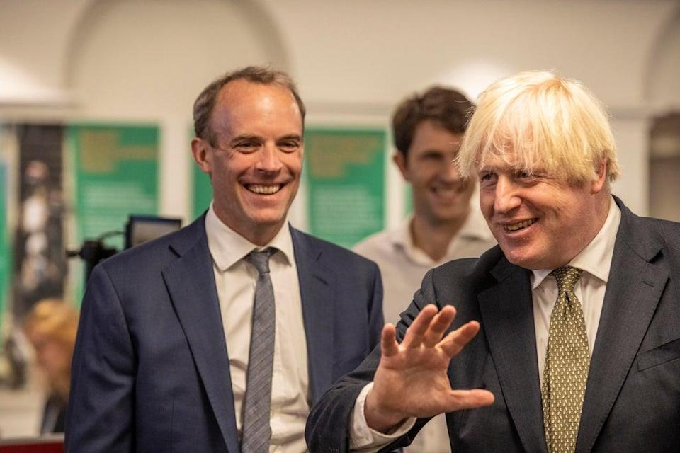 Boris Johnson and Dominic Raab visiting the Foreign, Commonwealth and Development Office Crisis Centre in Whitehall, London, to see how they are supporting and monitoring the ongoing evacuations in Afghanistan (PA)