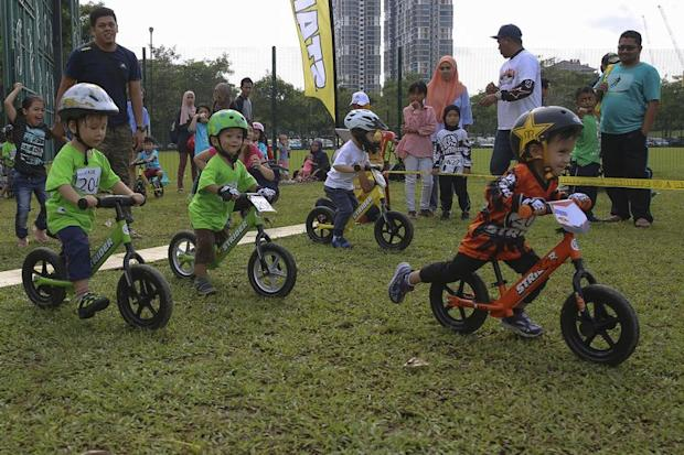 Mohammad Aariz, 2, in orange, racing in the Category 2A of Strider Cup Malaysia.