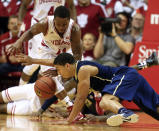Indiana's Yogi Ferrell (11) and Pittsburgh's James Robinson battle for a loose ball during the second half of an NCAA college basketball game Tuesday, Dec. 2, 2014, in Bloomington, Ind. Indiana won 81-69. (AP Photo/Darron Cummings)