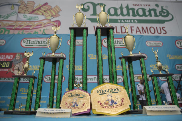 <p>The trophies and champion belts are on display on stage ahead of the Nathan's Famous Fourth of July hot dog eating contest, Wednesday, July 4, 2018, in New York's Coney Island. (Photo: Mary Altaffer/AP) </p>