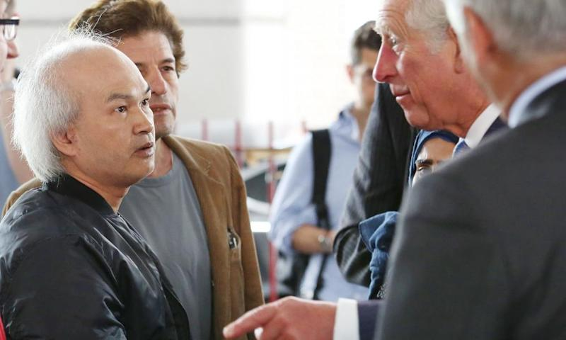 Anh Nhu Nguyen, left, meeting Prince Charles after the Grenfell Tower disaster