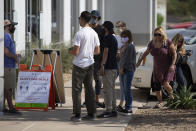 Arriving voters are given safety instructions by a poll worker at the Living Word Bible Church voting station in Phoenix, Ariz., on Election Day Tuesday, Nov. 3, 2020. (AP Photo/Dario Lopez-MIlls)
