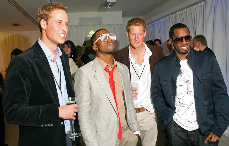 Prince William and Prince Harry do their best to look cool next to Kanye West and P Diddy (R) during a backstage party at Wembley Arena in July 2007 after the concert for their late mother Diana. (Carl de Souza/AFP)