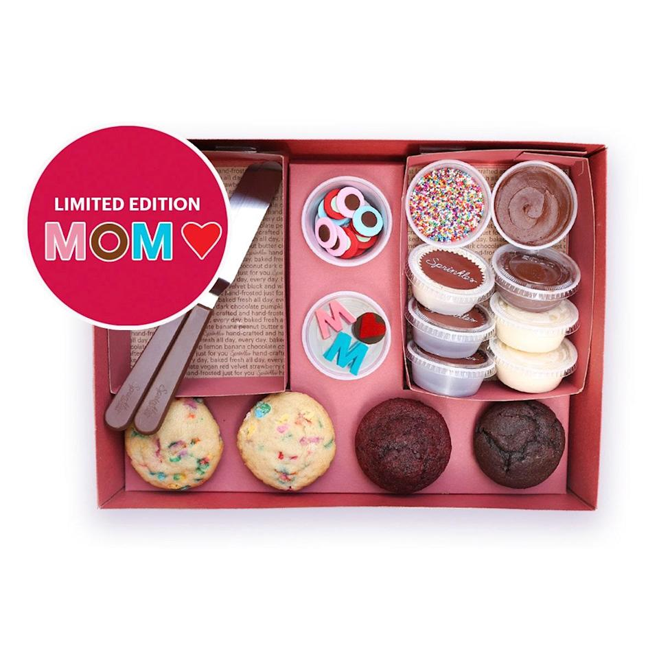 "Clear the afternoon for a fun (and delicious) Mother's Day activity. Each DIY kit comes with four baked cupcakes, frosting, edible decorations, and decorating spatulas to sprinkle and swirl your heart out. $25, Sprinkles. <a href=""https://catering.sprinkles.com/order/"" rel=""nofollow noopener"" target=""_blank"" data-ylk=""slk:Get it now!"" class=""link rapid-noclick-resp"">Get it now!</a>"