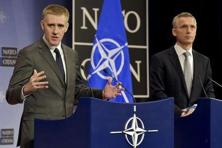 NATO Secretary General Jens Stoltenberg (R) holds a news conference with Foreign Minister of Montenegro Igor Luksic after a NATO foreign ministers meeting at the Alliance's headquarters in Brussels, Belgium, December 2, 2015. REUTERS/Eric Vidal