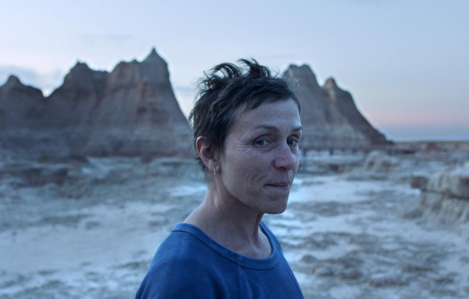 """This image released by Searchlight Pictures shows Frances McDormand in a scene from the film """"Nomadland,"""" named one of the top 10 films of the year by The American Film Institute. (Searchlight Pictures via AP)"""