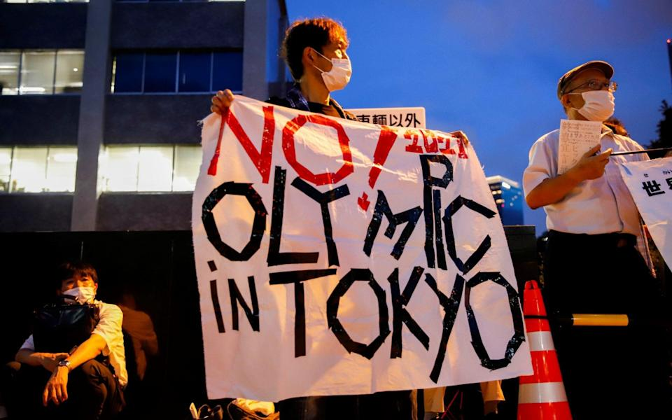 Anti-Olympic protesters gather outside Japanese Prime Minister Yoshihide Suga's office in Tokyo, Japan on 29 July 2021 - Androniki Christodoulou/Reuters