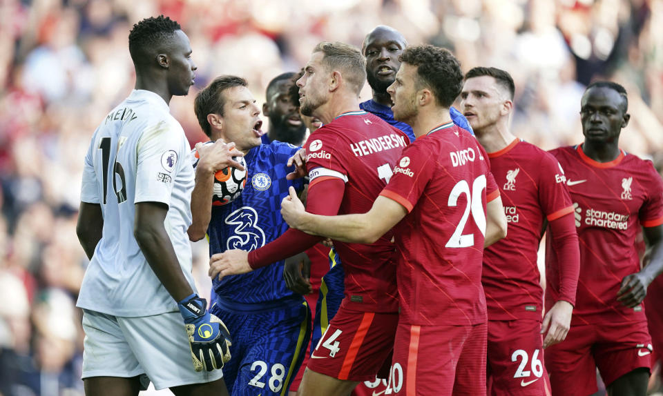 Chelsea's Cesar Azpilicueta, second left, and Liverpool's Jordan Henderson, third left, clash following Liverpool's equaliser during the English Premier League soccer match between Liverpool and Chelsea at Anfield, Liverpool, England, Saturday, Aug. 28, 2021. (Mike Egerton/PA via AP)