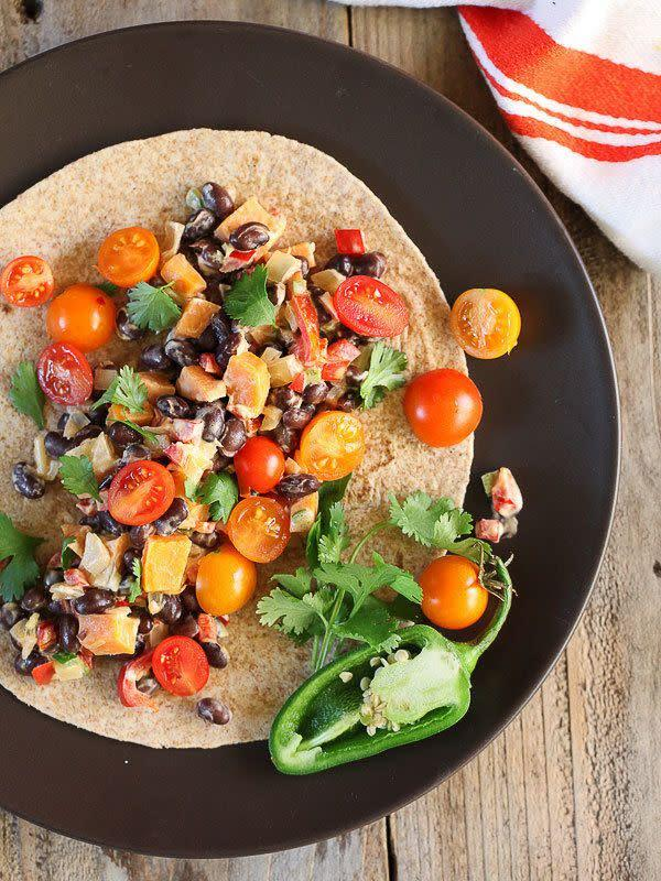 "<strong>Get the <a href=""http://www.foodiecrush.com/sweet-potato-black-bean-burritos/"" rel=""nofollow noopener"" target=""_blank"" data-ylk=""slk:Sweet Potato and Black Bean Burrito recipe"" class=""link rapid-noclick-resp"">Sweet Potato and Black Bean Burrito recipe</a>&nbsp;from Foodie Crush</strong>"