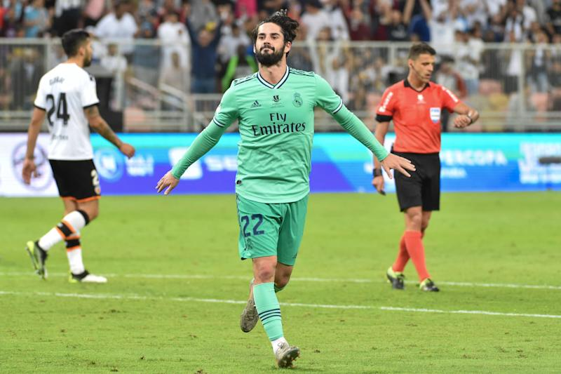 Real Madrid's Spanish midfielder Isco celebrates his goal during the Spanish Super Cup semi final between Valencia and Real Madrid on January 8, 2020, at the King Abdullah Sport City in the Saudi Arabian port city of Jeddah. (Photo by FAYEZ NURELDINE / AFP) (Photo by FAYEZ NURELDINE/AFP via Getty Images)
