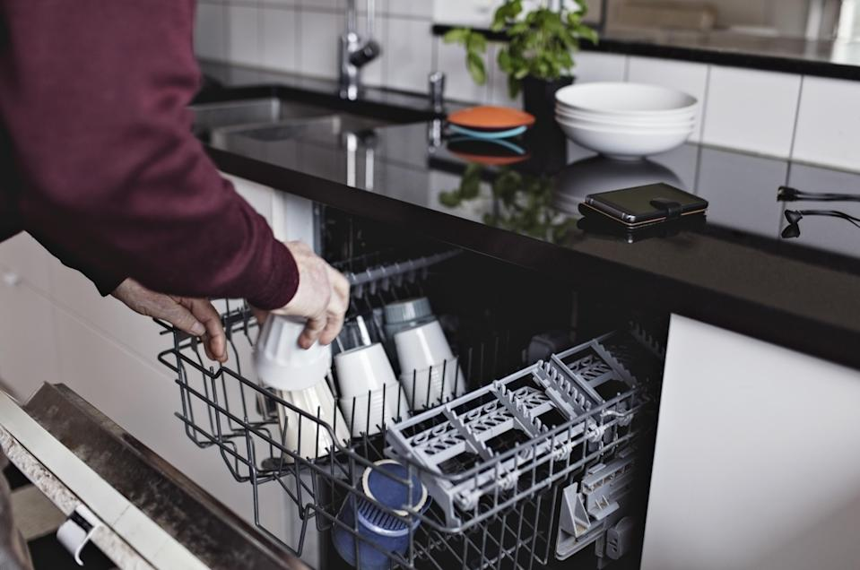 Your dishwasher must be cleaned as thoroughly as your plates. (Photo: Getty)