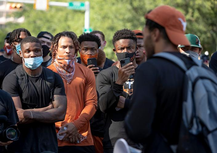 Texas football players listened to teammate Caden Strerns speak at the end of a team march to the Capitol on June 4 to protest the killing of George Floyd.