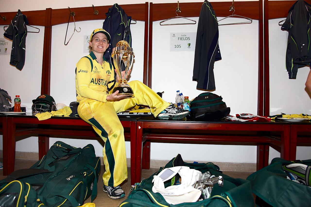 MUMBAI, INDIA - FEBRUARY 17:  Jodie Fields, winning  captain of Australia with trophy in the rooms after the final between Australia and West Indies of the Women's World Cup India 2013 played at the Cricket Club of India ground on February 17, 2013 in Mumbai, India. (Photo by Graham Crouch/ICC via Getty Images)
