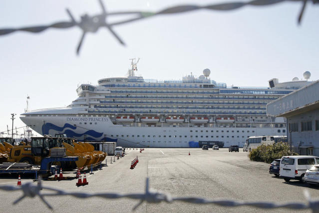 The quarantined ship Diamond Princess is pictured through barbed wire at Yokohama port. (AP)