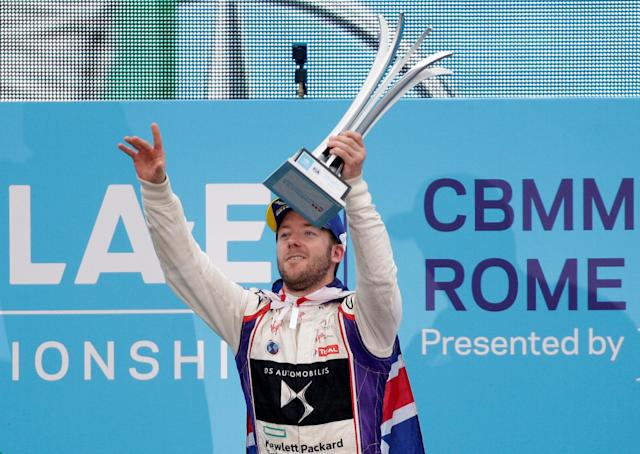 Motor Racing - Formula E - Rome ePrix - Rome, Italy - April 14, 2018 DS Virgin Racing's Sam Bird celebrates winning the race by lifting the trophy during the podium ceremony REUTERS/Max Rossi