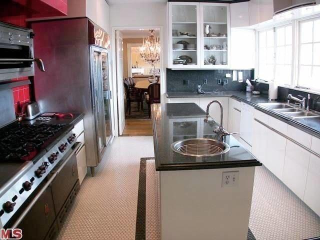 "<p>The dark surfaces in this kitchen paired with clunky and busy patterns made this <a href=""https://www.housebeautiful.com/room-decorating/kitchens/a2058/make-a-room-look-larger-makeover-elle-decor/"" rel=""nofollow noopener"" target=""_blank"" data-ylk=""slk:space"" class=""link rapid-noclick-resp"">space</a> feel smaller than the square footage.</p>"