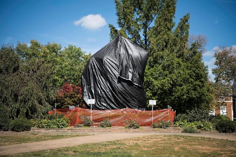The statue of Confederate Gen. Robert E. Lee that sparked protests in August sits covered in plastic in Charlottesville, Virginia.