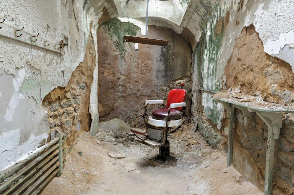 """<p>Eastern State Penitentiary has long since been considered one the most haunted places in <a href=""""https://www.housebeautiful.com/design-inspiration/house-tours/a3808/modern-philadelphia-castle/"""" rel=""""nofollow noopener"""" target=""""_blank"""" data-ylk=""""slk:Philly"""" class=""""link rapid-noclick-resp"""">Philly</a>. The building was the largest American prison at its completion in 1829 and remained operational until 1971, serving as the model for hundreds of prisons in the 19th and 20th centuries. Infamous criminals like Al Capone and Willie Sutton were inmates here — but the penitentiary is even <em>more</em> famous for its associations with the occult. It's been featured on countless ghost shows, like Travel Channel's <em>Ghost Adventures,</em> Syfy's <em>Ghost Hunters,</em> and MTV's <em>Fear</em><span class=""""redactor-invisible-space"""">, but even more convincing are the accounts of those who have been inside the prison and unknowingly confirmed each other's accounts. Certain cell blocks are associated with different chilling events, like <a href=""""http://www.npr.org/2013/10/24/232234570/is-eastern-state-penitentiary-really-haunted"""" rel=""""nofollow noopener"""" target=""""_blank"""" data-ylk=""""slk:echoing voices, cackling, and wailing"""" class=""""link rapid-noclick-resp"""">echoing voices, cackling, and wailing</a>. </span>Its colloquial acronym, ESP, is <em>also </em><span class=""""redactor-invisible-space"""">the acronym for extrasensory perception, more commonly referred to as the """"sixth sense."""" Coincidence? We think not.</span></p>"""