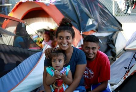 Honduran migrants Marvin Madrid and his new wife Dexy Maldonado speak during an interview with Reuters in an encampment in Matamoros